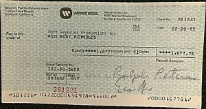 BURT-REYNOLDS-RARE-ORIGINAL-1985-PERSONAL-PAYROLL-CHECK-FROM-WARNER-BROTHERS