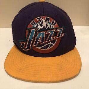 a67ad769eba543 NBA Utah Jazz Mitchell & Bess Hardwood Classics Purple Gold Snapback ...