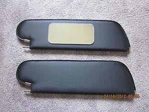 1971-72 Grand Prix single pin sun visors with vanity mirror white perforated