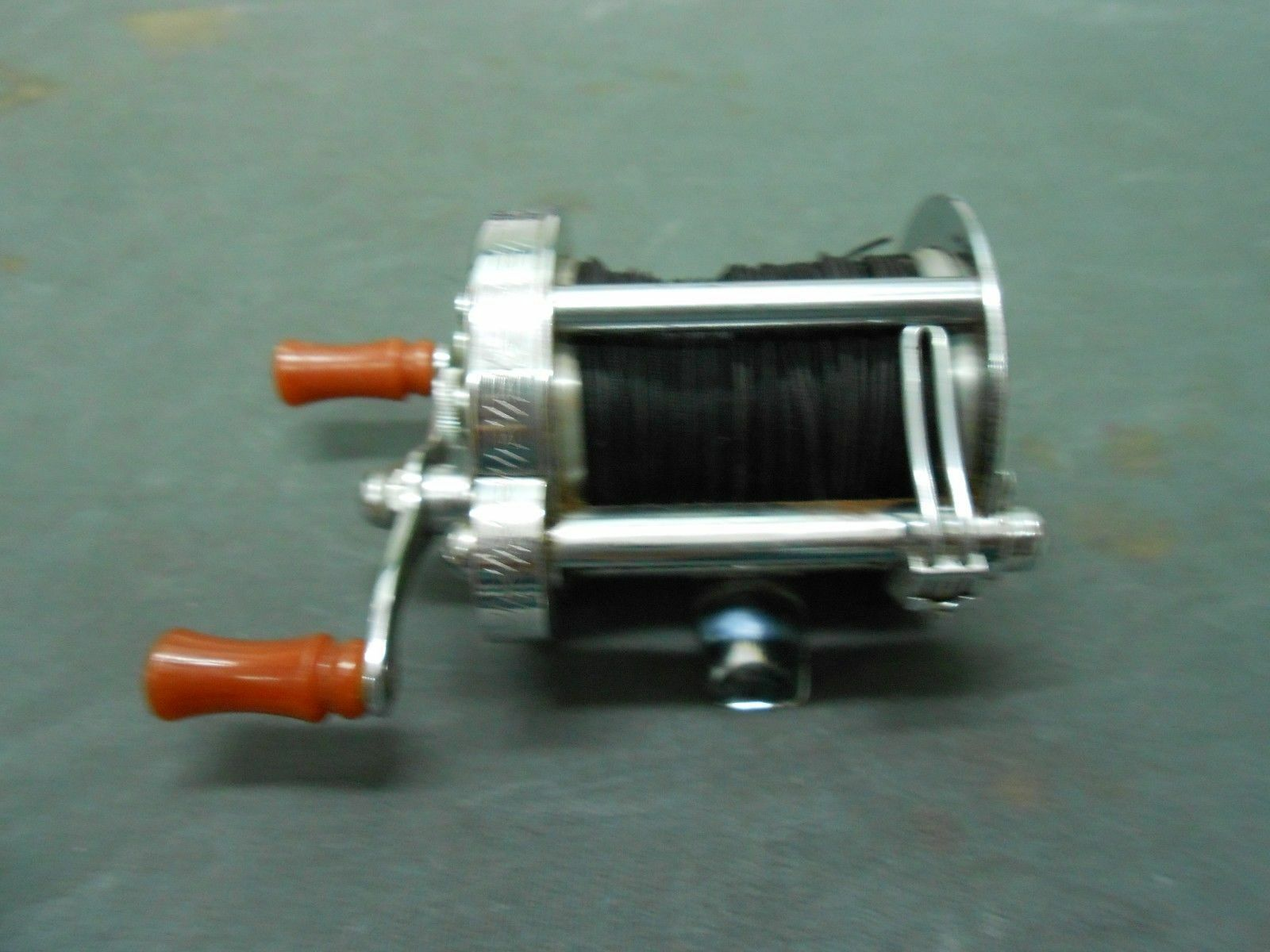 NICE PFLUEGER AKRON NO 1893 L CASTING REEL  VERY SMOOTH OPERATING
