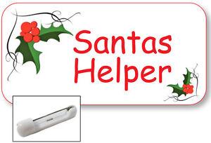 white name badge tag for santas helper christmas artwork safety pin