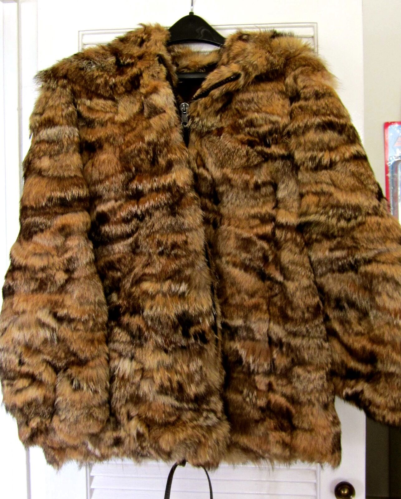 60'S VINTAGE WOMAN'S HOODED COYOTE FUR COAT. SIZE 14 MEDIUM. BEAUTIFUL CONDITION