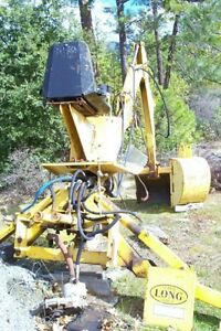 Backhoe-attachment-included-buckets-came-off-a-New-Holland-Long-Tractor