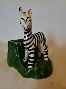 Handmade-7-034-Ceramic-Planter-Zebra-Standing-In-Front-Of-Green-Tree-Trunk