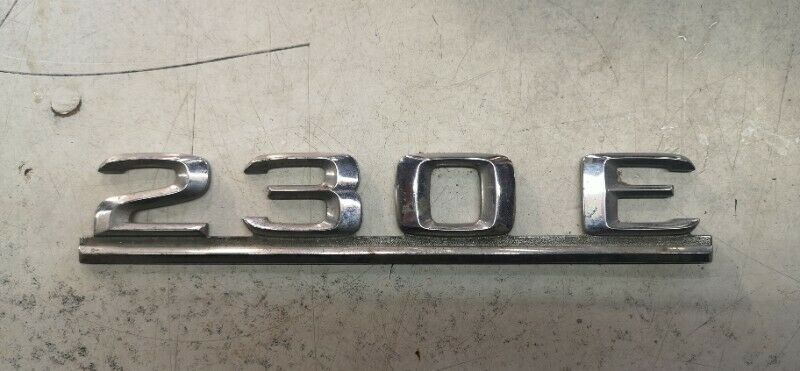 Mercedes Benz 230e badge emblem