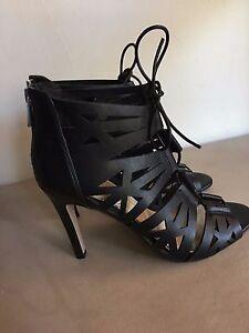 94e0997d39 Jessica Simpson black laser cut 3 7/8 back zip heels open toe lace ...