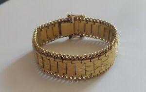 Imposant-bracelet-en-plaque-or-jaune-18-k