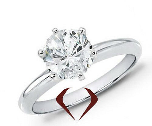0.63 CT Round Diamond Solitaire Ring F I1 14K