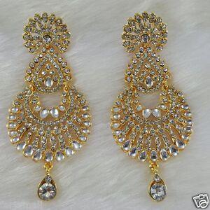 gold plated kundan style zerconic earrings designer