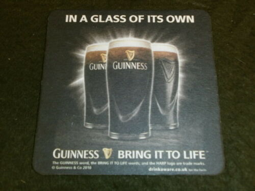 GUINNESS IN A GLASS OF ITS OWN BEERMAT