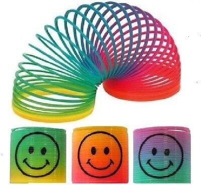 24 x Rainbow Smiley Face Springs Slinky Boys Girls Party Bag Filler Toys T65 013