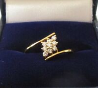 .SECONDHAND 18ct YELLOW GOLD 9 STONE DIAMOND CLUSTER TWIST RING.