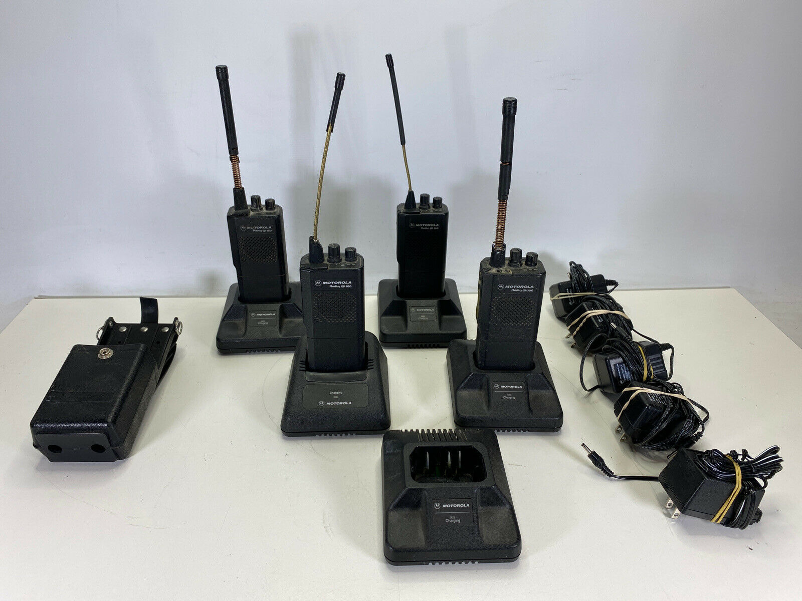 LOT OF 4 Motorola Radius GP 300 GP300 UHF Radios with 5 Chargers and Holster. Buy it now for 99.99