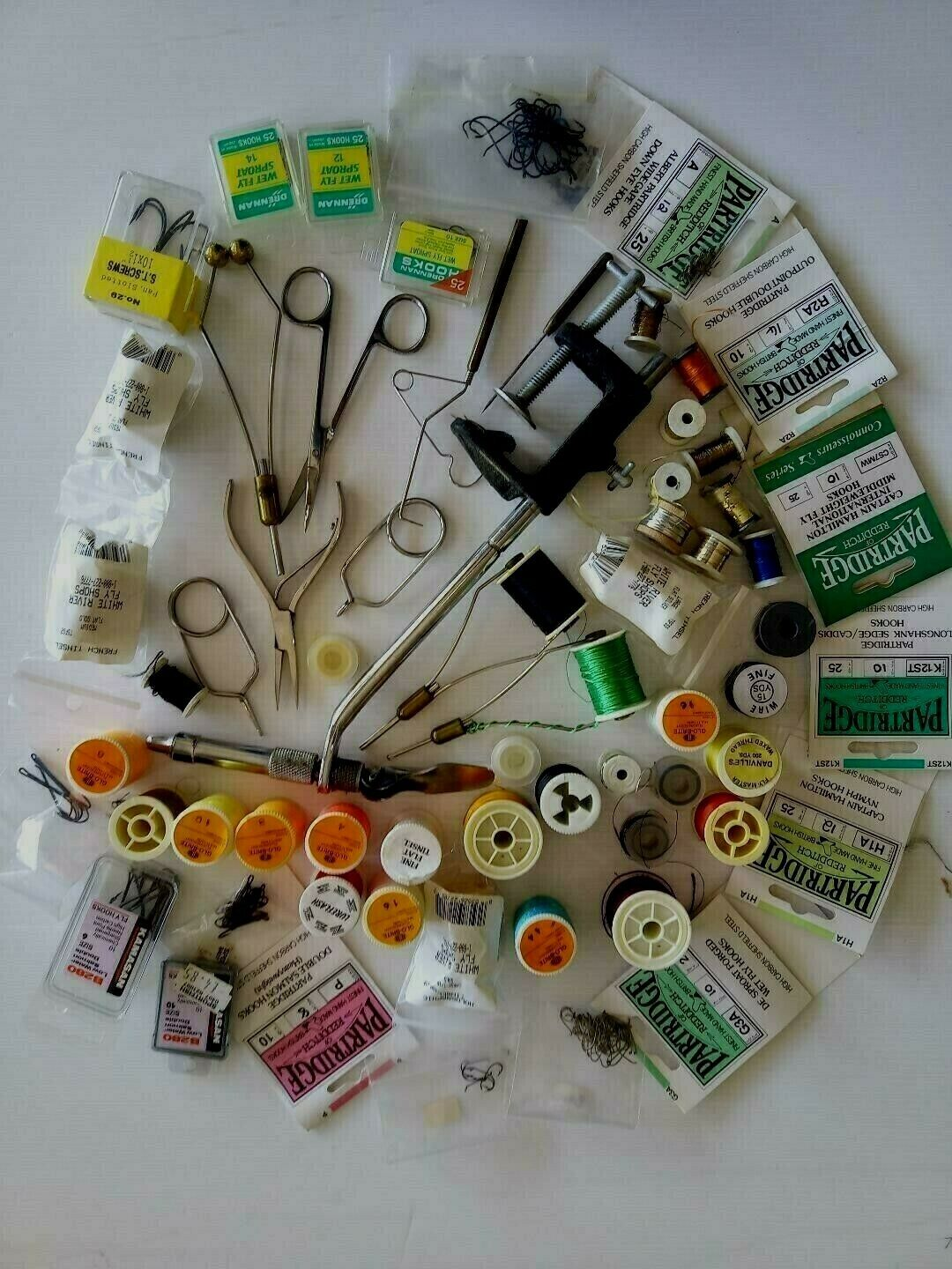 Fly fishing tying tools, selection of hooks T&S and fly tying materials.