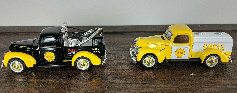 Dos Shell oroen Wheel camiones coches de fundición