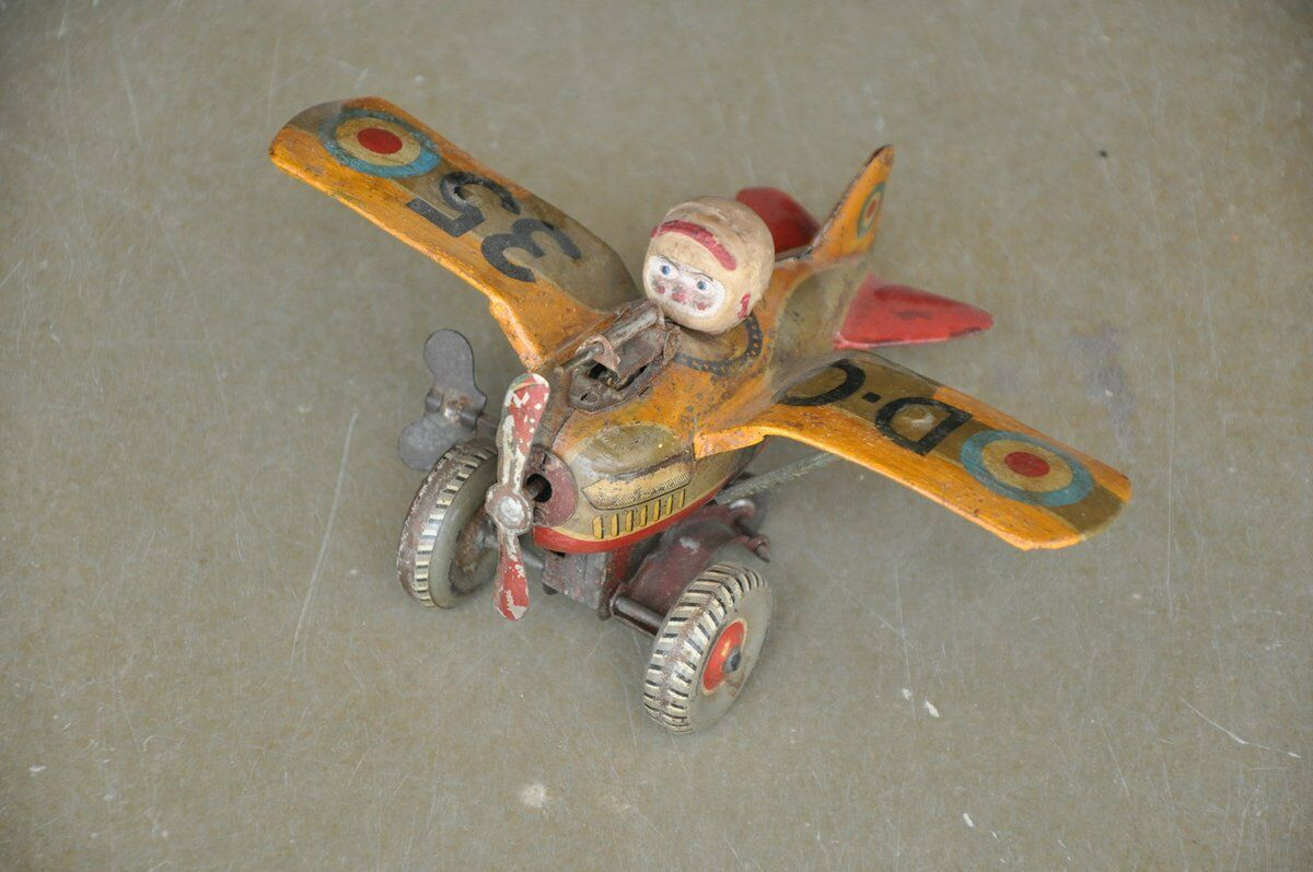 Vintage Wind Up D-o 35 Fire Sparkle Litografía Fighter Avión Juguete de hojalata, Japón