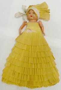OLD VINTAGE 7 INCH CELLULOID DOLL WITH PAPER SKIRT