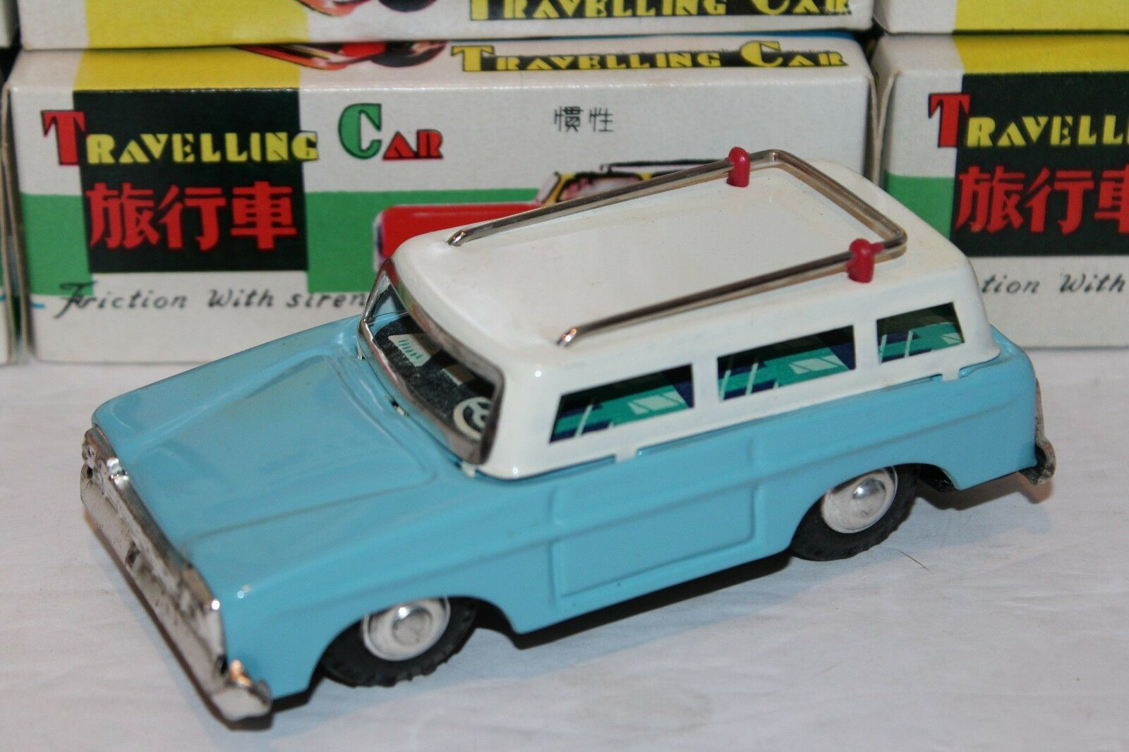 VERY NICE blueE TIN FRICTION POWERED TRAVELING STATION WAGON WITH SOUND in BOX