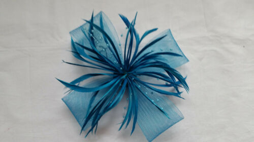 Brightly coloured Large looped net and feather fascinator on a forked clip and