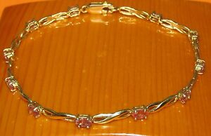 STUNNING SECONDHAND 18ct YELLOW GOLD PINK SAPPHIRE LINE BRACELET 20cm - London, London, United Kingdom - Returns accepted Most purchases from business sellers are protected by the Consumer Contract Regulations 2013 which give you the right to cancel the purchase within 14 days after the day you receive the item. Find out more - London, London, United Kingdom