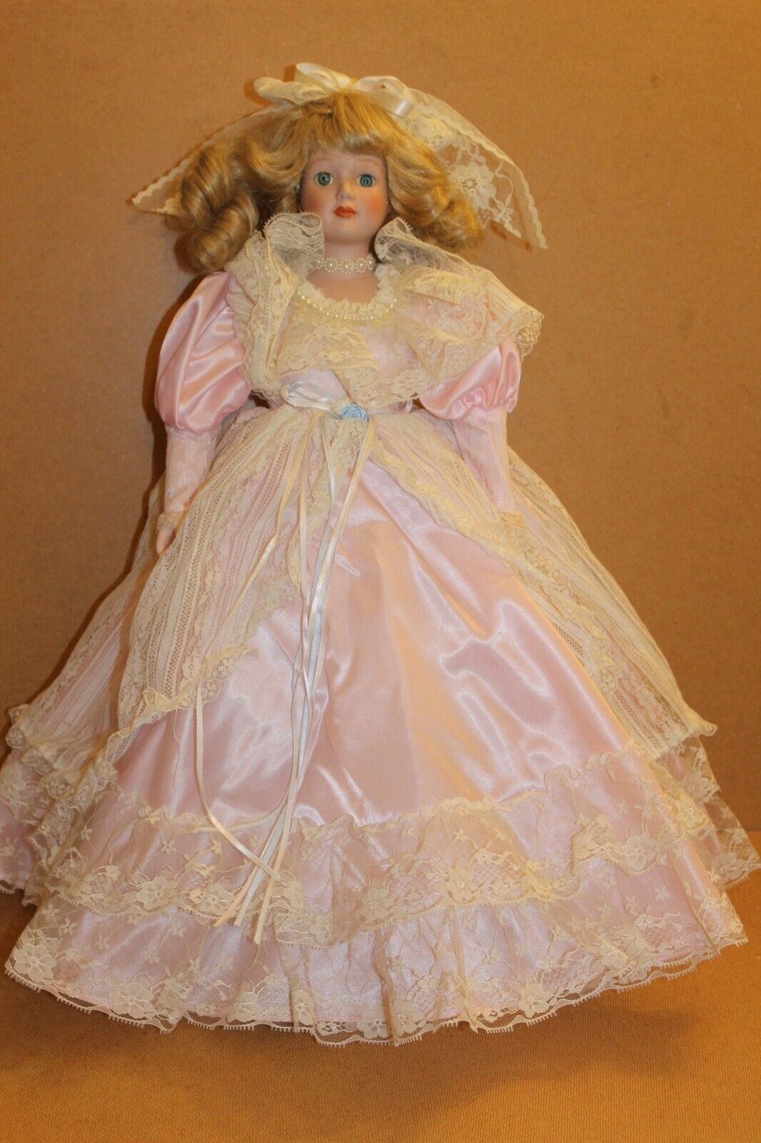 """Porcelain Doll,22"""" tall on stand peach vicitorian style dress"""