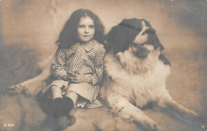 R303677 Unknown. Photo with girl and dog. A. 604. 4. Post Card
