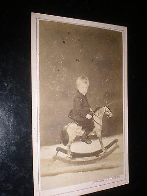 Cdv old photograph boy on rocking horse by Neuwirth at Oedenburg Hungary? c1870s