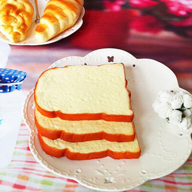 1PCS 14CM Jumbo Squishy Soft Scent sliced Bread Toast Kids Toy Hand Pillow ZYRA