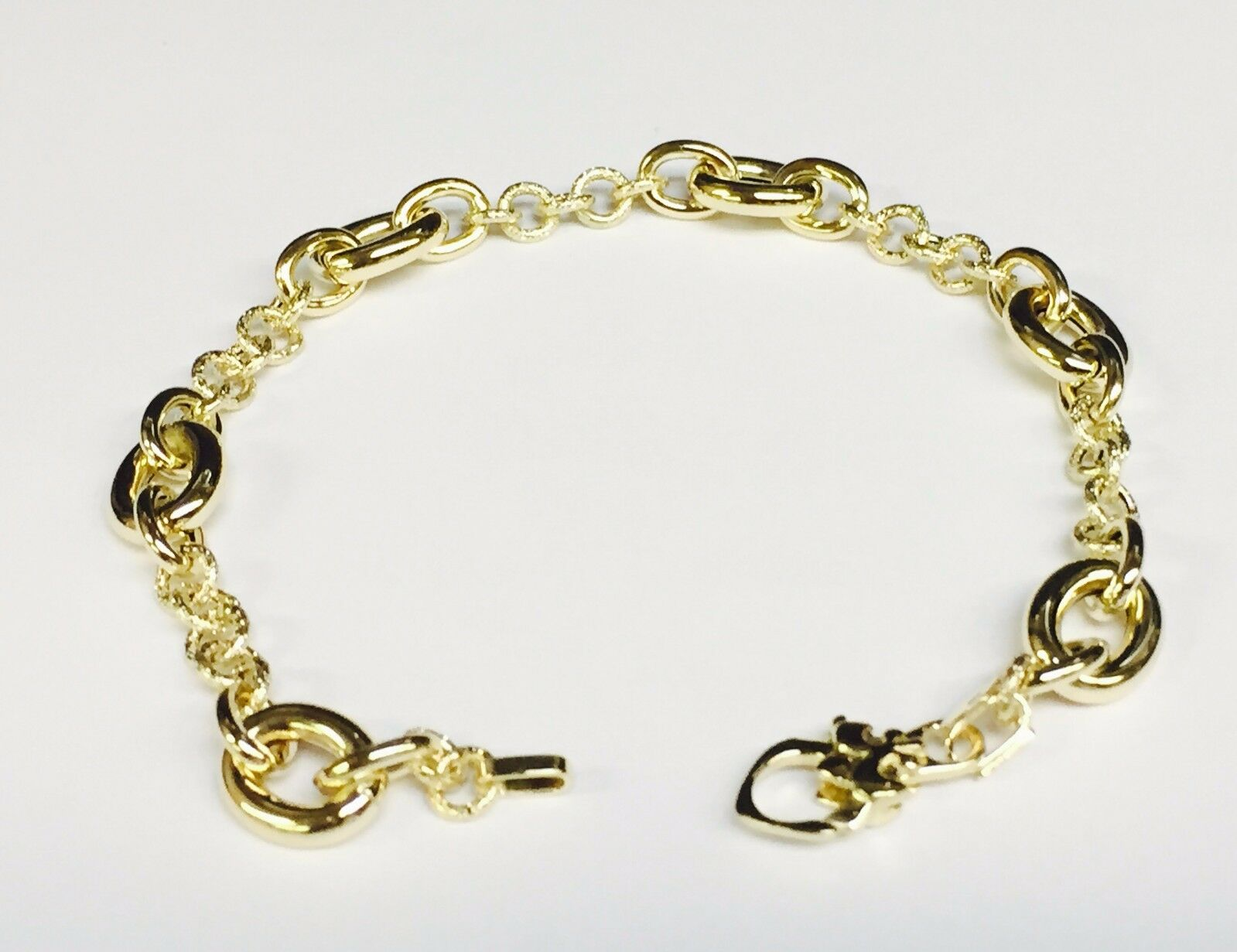 14kt Yellow gold DESIGNER FASHION link BRACELET 7.5   8.5 MM  5 grams