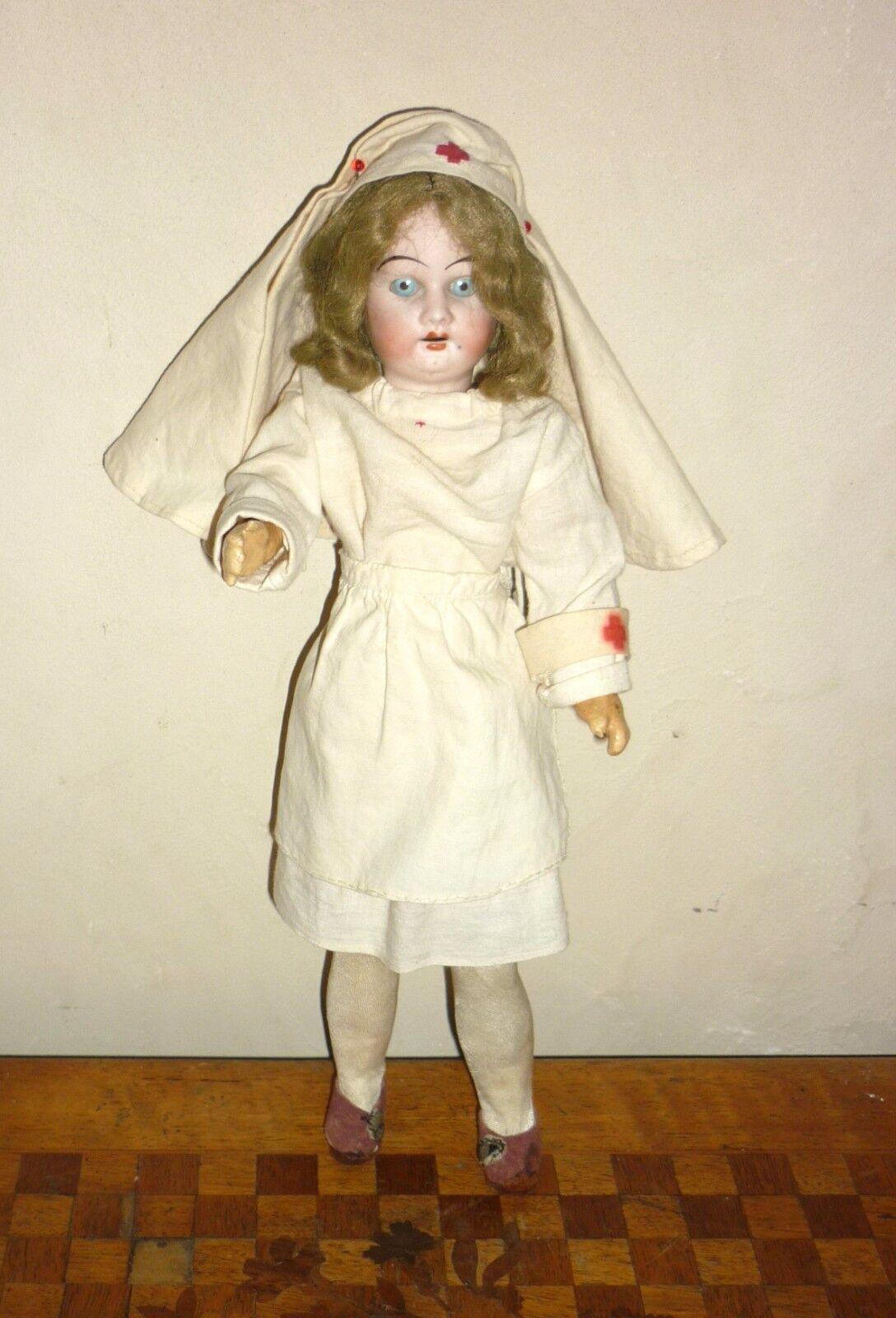 Poupée ancienne Infirmière en porcelaine 185 16 0 mignonnette H  29cm antik doll