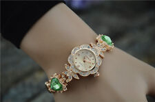Fancy Ladies Rhinestone Watch With Round Dial and Green Stone