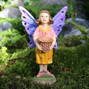 Miniature-garden-fairy-with-butterfly-wings-and-basket-for-fairy-garden