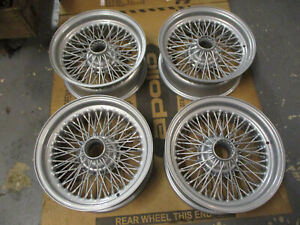 6-x-15-inch-70-spoke-wire-wheels-rebuilt-silver-set-of-5-AC-Cobra-DB5-Morgan