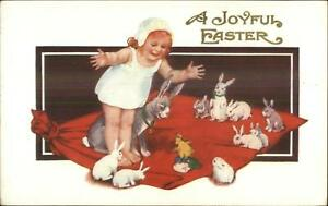 Easter-Cute-Little-Girl-w-a-Bunch-of-Rabbits-on-Blanket-Embossed-Postcard