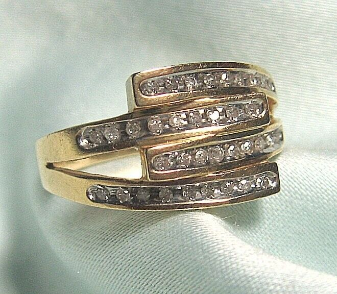 14K gold and Diamond Ring 5.6 grams size 9 1 2   approx .30 ct diamonds total