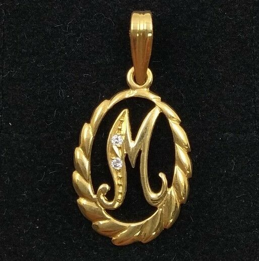 Pendant gold 18k. Initial name letter M with zircons