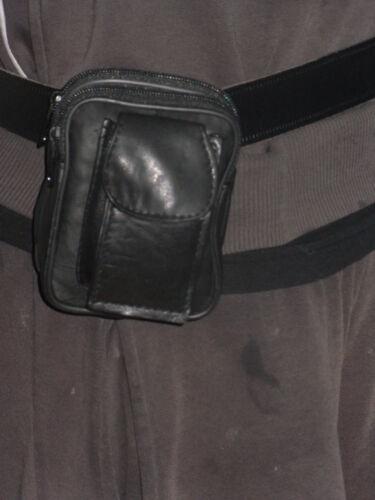 Une ceinture en cuir souple sac à main sac avec double fermeture à glissière poches et poche pour téléphone.