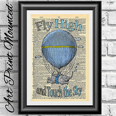 Nursery print elephant air balloon on original antique dictionary book page blue