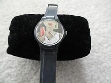 Swiss Made Quartz Ladies Watch - Lady holding a can of Coke