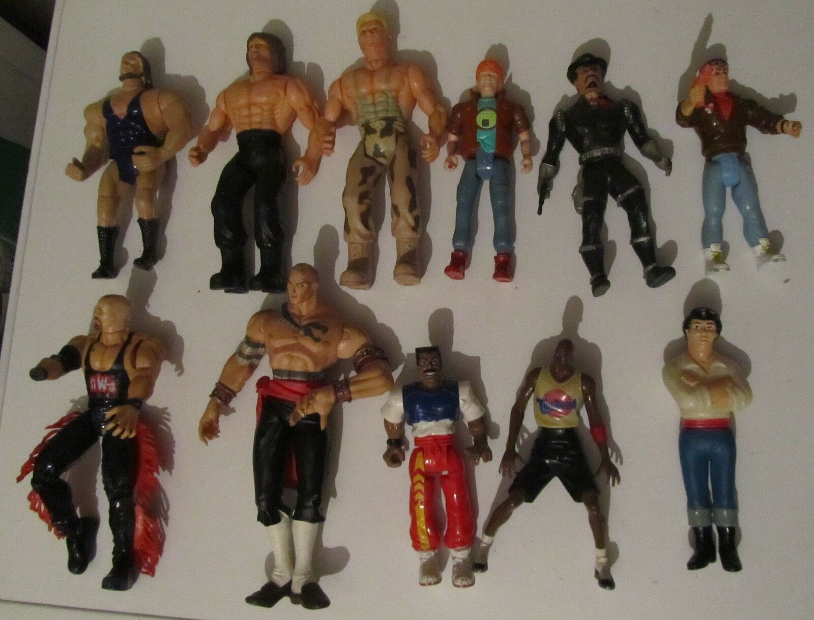 Lotto 11 Wrestler e varie action figuyre Vintage Wrestling wwf james bond junior