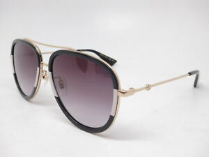 50d7bbe12 La foto se está cargando Nuevo-Autentico-Gucci-GG0062S-006-Negro-Oro-Con-