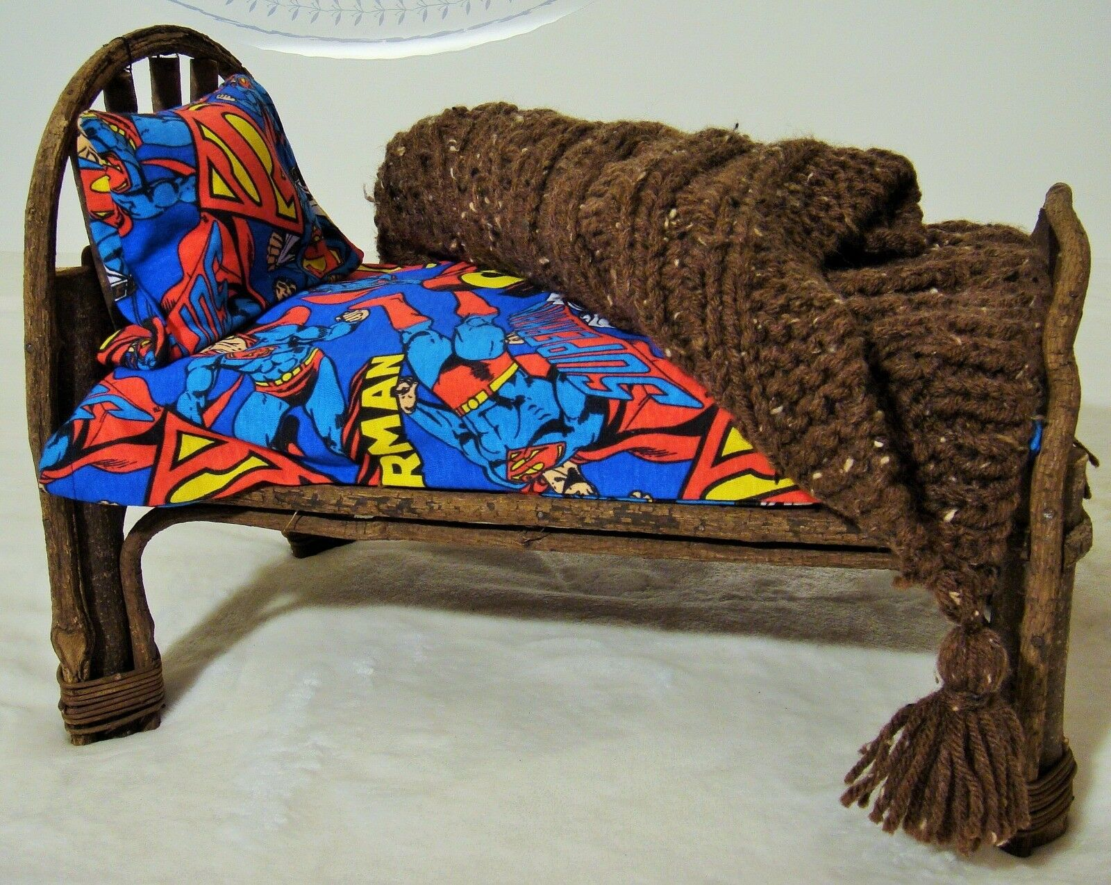 Boyds Bear Bed with Hand Knit Aran throw and Superman bed sheet