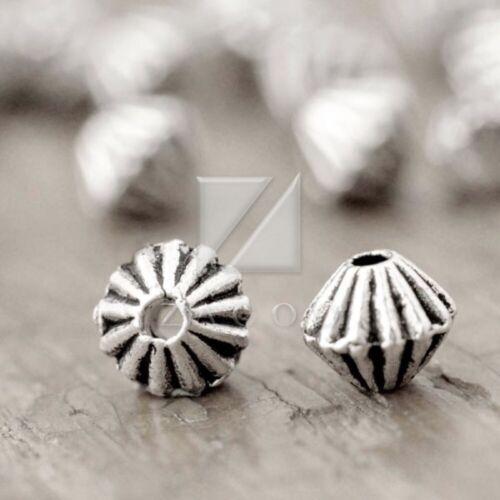 encanto granos del metal suelto espaciador Plata Tibetana Bisutería Bicono 12x12x4mm 500 un