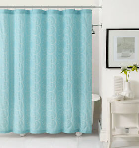 light aqua blue fabric shower curtain with white