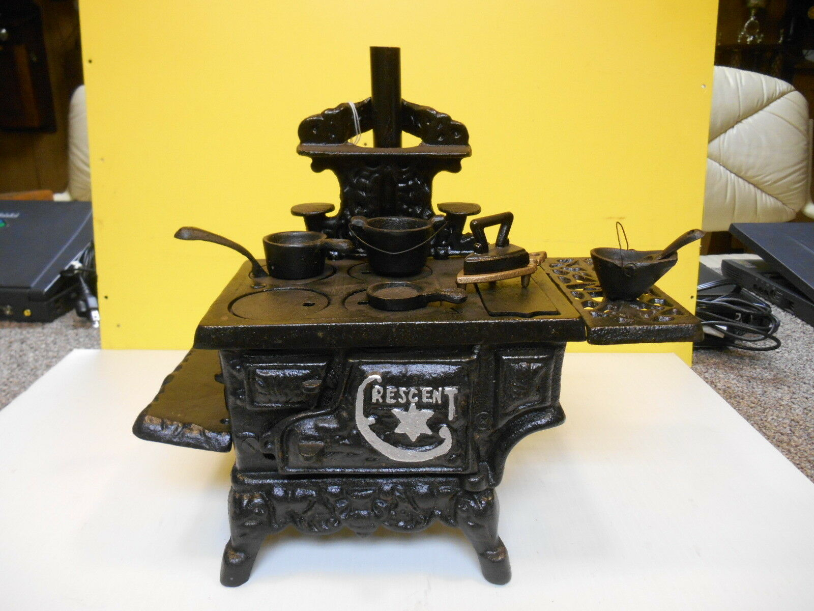 VINTAGE CRESCENT CAST IRON TOY STOVE WITH 8 ACCESSORIES  WEIGHS 9 1 /2 LBS.