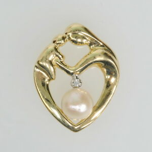 91ddc5d1607fd Ladies 10k Yellow Gold Pearl Diamond Heart Mother Child Charm ...