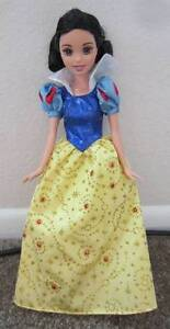 snow white barbie doll sequins  gold glitter on her dress