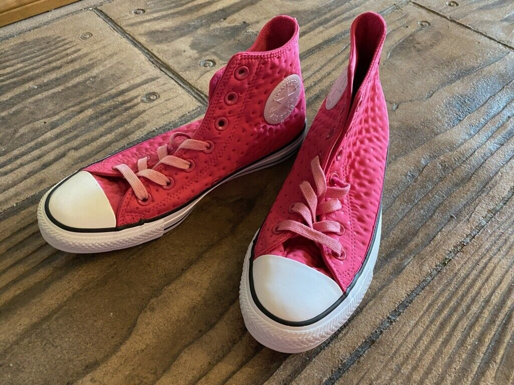 Pink Chuck Taylor Converse All Star high top shoes