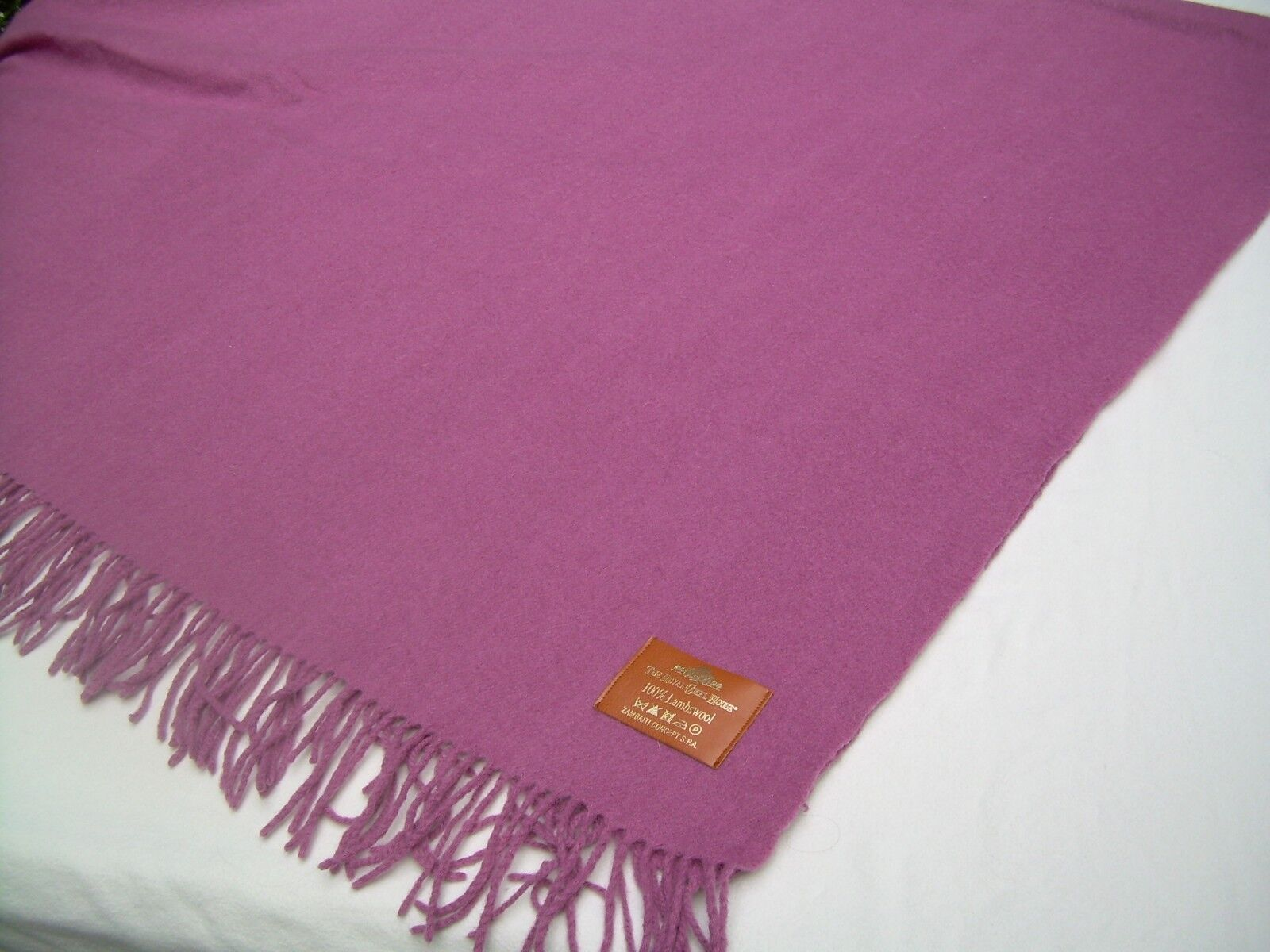 100% lambswool throw fringedZambaiti Concept SPARoyal Camel Housemauve