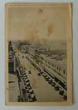 VINTAGE POSTCARD CARS ON 10TH STREET LOOKING SOUTH MODESTO CALIFORNIA CA